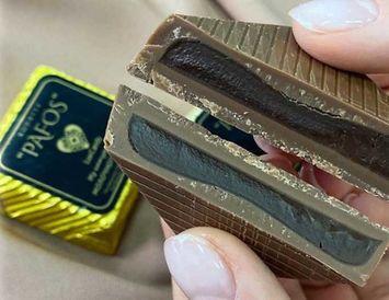 Конфета молочный шоколад с начинкой темный шоколад 1 шт.